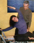 Tom McCook gives wife Karen deMoor pointers on her Pilates technique in their Moss Beach home